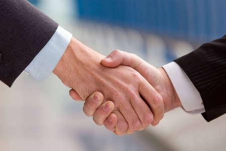 trust people: Two business men shaking hands