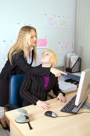 subordinated: Two young employees of office in an operating time