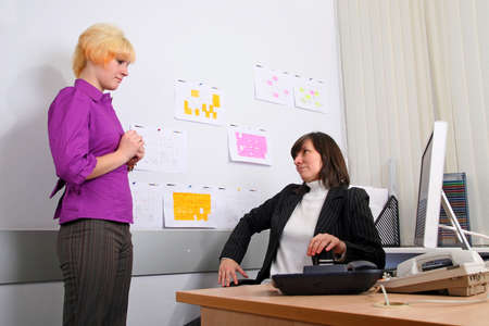 subordinated: Sad employee of office faces to the chief Stock Photo