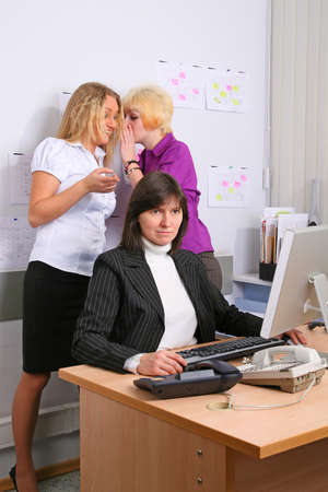 subordinated: Two employees of office sneer at the colleague