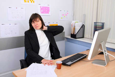 subordinated: The employee of office with a sick neck