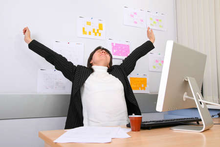 subordinated: The employee of office stretches on a workplace