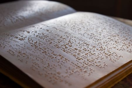 page written in braille alphabet for blind people photo