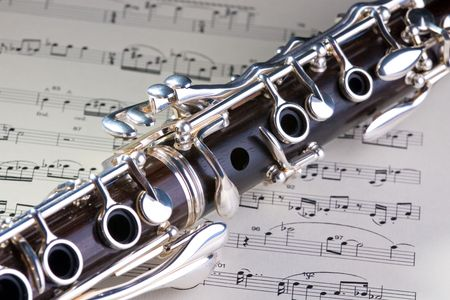 Wooden wind musical instrument clarinet. Close-up.