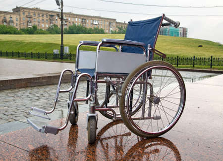 wheelchair on a background of a city landscape Stock Photo - 5163376