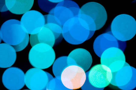 Abstract multi coloured light on a black background photo