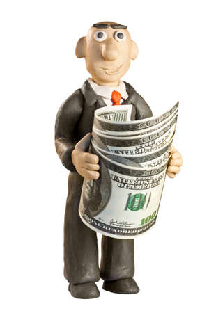 plasticine businessman with money over white background photo