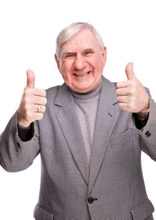 m�s viejo: hombre Senior mostrando pulgar sobre un fondo blanco aislado Foto de archivo