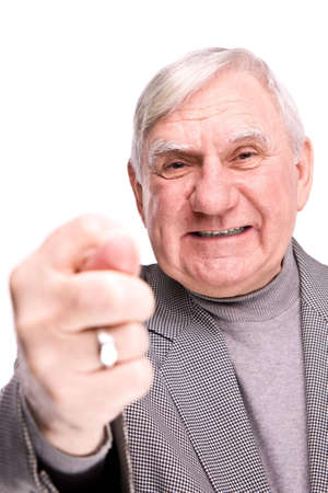 senior man showing fig on a isolated white background Stock Photo - 6402586