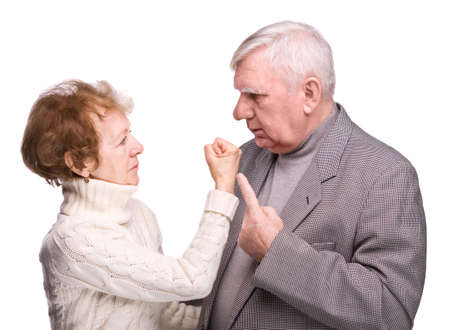 controversy: Conflict elderly couple on a white background Stock Photo