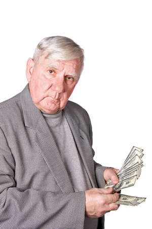 75s: Elderly man considers money. Isolated on a white background