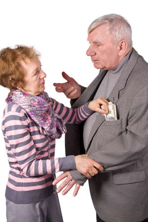 Elderly pair. Wife takes from husband of money. It is isolated on white photo