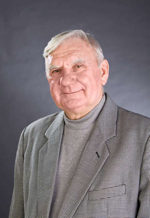 1 mature man: Portrait of elderly man ?n a grey background