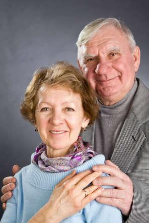 Senior Couple Isolated on a Grey Background photo
