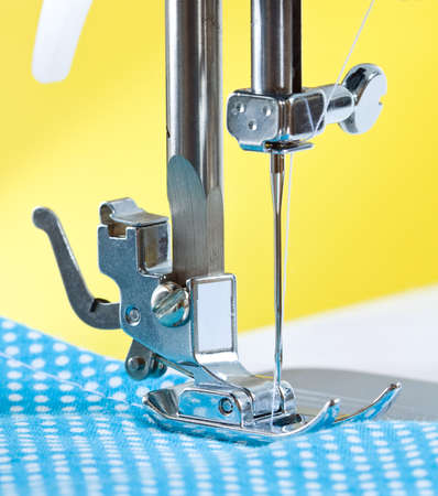 Close-up of sewing machine and fabric