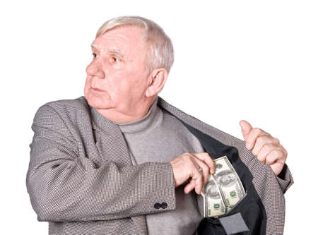 75s: Elderly man puts money in an internal pocket of a jacket. It is isolated on a white background Stock Photo