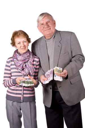 Elderly married couple with money in hands. Isolated on a White Background photo