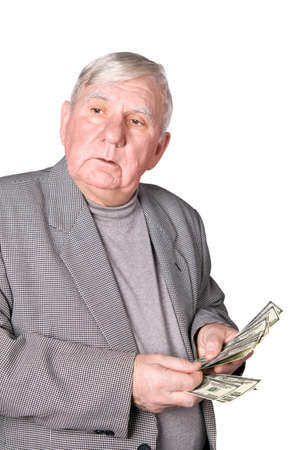 greedy: Elderly man considers money. Isolated on a white background