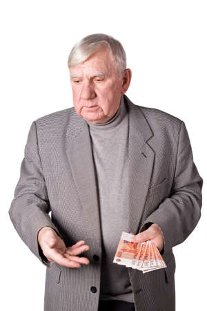 75s: Elderly man with money in hands. It is isolated on a white background