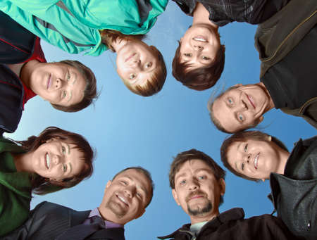 head down: Group of eight people against the sky