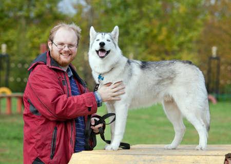 Man with a dog breed Siberian Husky Stock Photo - 7940775