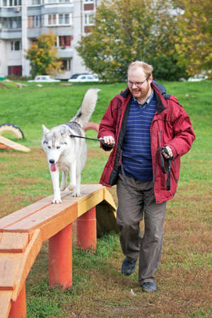 Man with a dog breed Siberian Husky photo