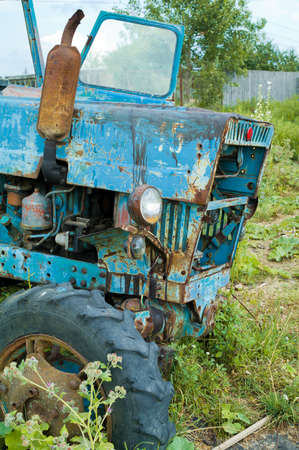 Old abandoned  tractor, rusty and broken photo