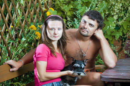 Young couple with a dog miniature schnauzer photo