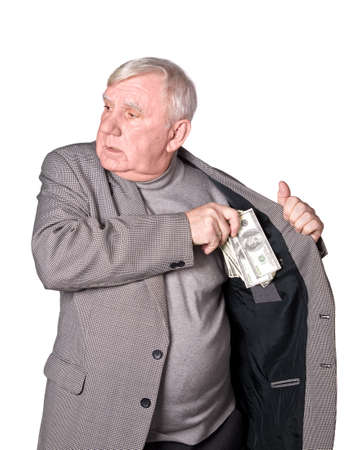 Elderly man puts money in an internal pocket of a jacket. It is isolated on a white background photo