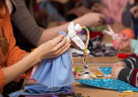 Russian folk crafts. Making rag doll Vesnyanka photo