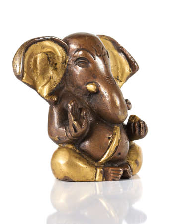 Ancient Statuette of Ganesha isolated on a white background photo