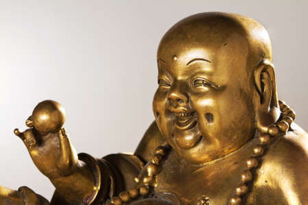 Ancient Figurine Cheerful Hotei. Chinese God of Wealth. photo
