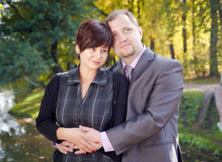 Beautiful young couple in the autumn park photo