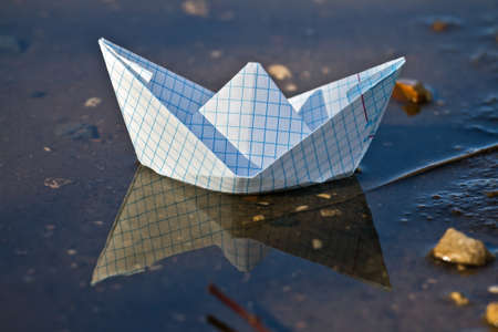 Toy boat of paper in the water  Stock Photo - 9658051