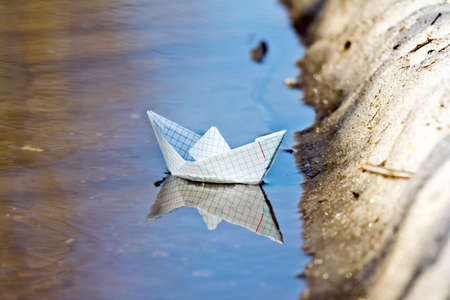 navigate: Toy boat of paper in the water
