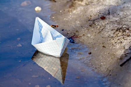 Toy boat of paper in the water