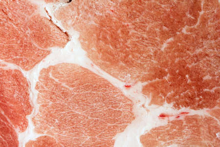 Frozen meat: Slice uncooked pork chops closeup Stock Photo
