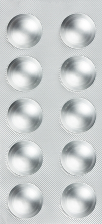 Pills in blister packs as a background photo