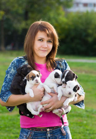 amstaff: Young Women Holding Five Cute Little Puppies American Staffordshire Terrier
