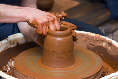 spinning wheel: Close-up of hands making pottery on a wheel Stock Photo