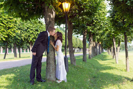 Portrait young happy bride and groom outdoor photo