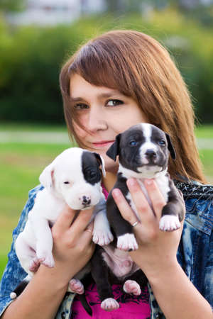 amstaff: Young Women Holding Two Cute Little Puppies American Staffordshire Terrier