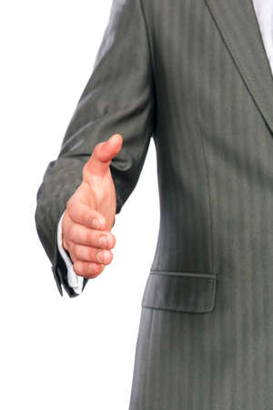Mid section of a business man offering handshake isolated on white photo