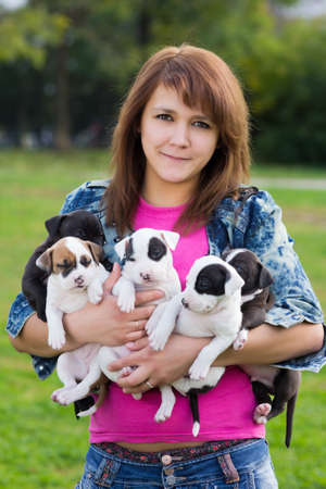 amstaff: Young Women Holding Five Little Puppies American Staffordshire Terrier