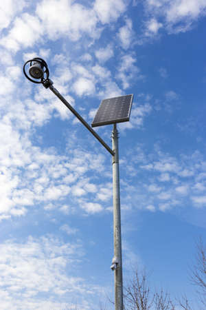 standalone: Stand-alone street light with solar battery on sky background  Renewable Energy Stock Photo