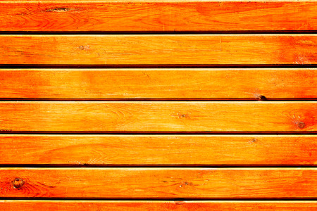 Wall of orange wooden planks