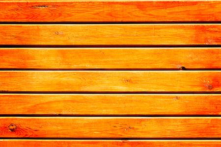 Wall of orange wooden planks