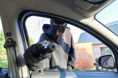 Villain with a gun threatened driver