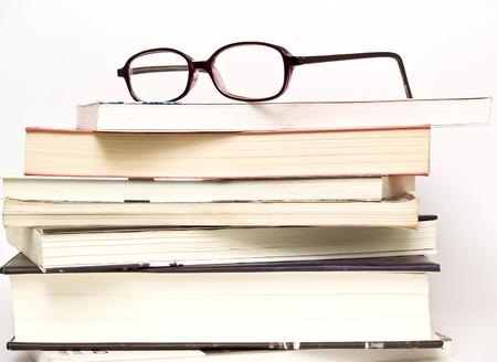 Eyeglasses on book photo
