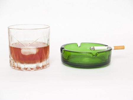 glass of whiskey, cigarettes and ashtray photo